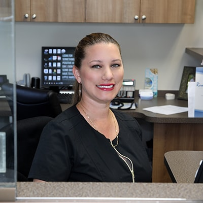 Jennifer helping with forms at your dentist in Palm Beach Gardens FL