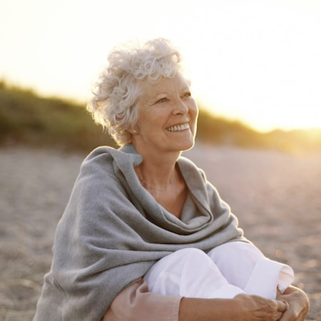 Smiling woman after she had implants by your dentist in Palm Beach Gardens FL