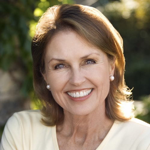 An older woman with dentures and Restorative Dentistry Palm Beach Gardens