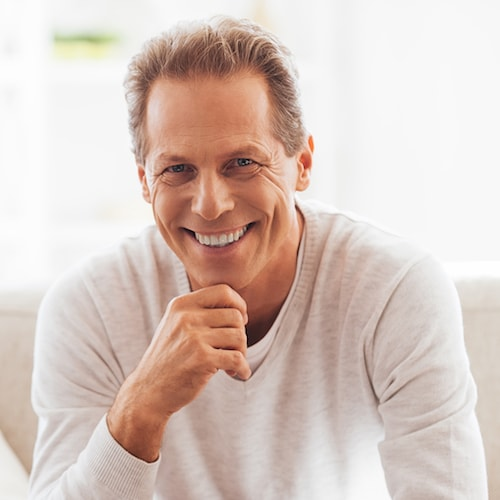 Happy man after a root canal and some Restorative Dentistry Palm Beach Gardens