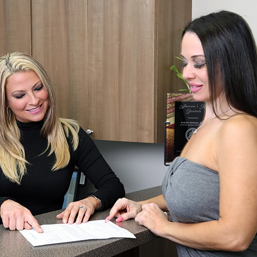 Your cosmetic dentist in Palm Beach Gardens team member speaking with a client